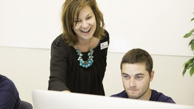Gretchen Samchuck works with a student