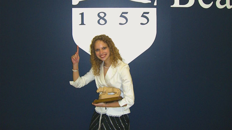 Jamie Silicki poses with her lion statue after winning the Walker Award.