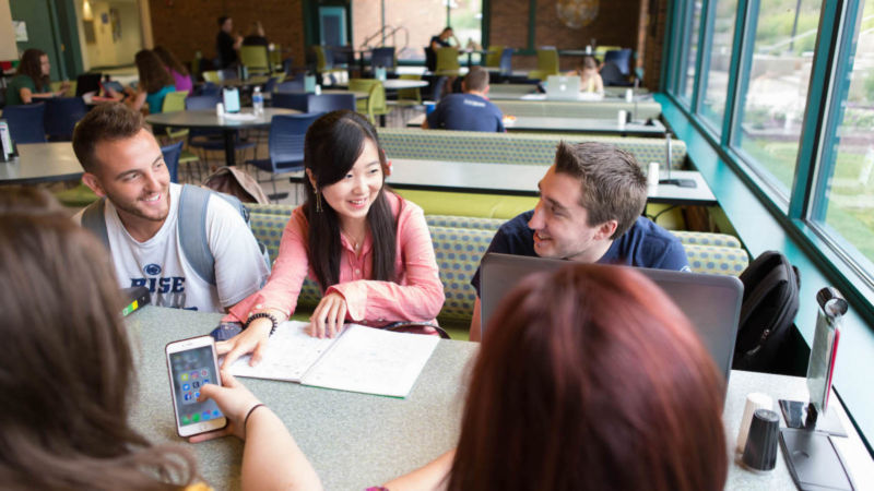 Eva Zhou sits with classmates in the Bistro.