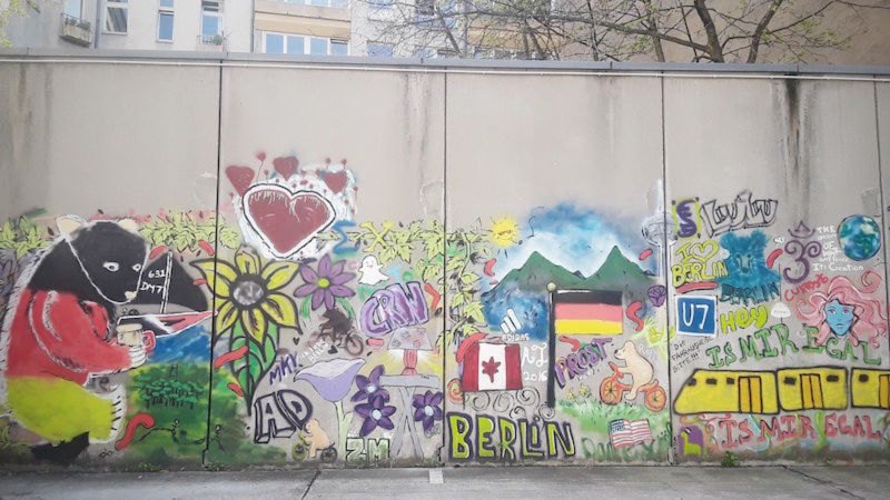 A wall in Berlin tagged with graffiti.