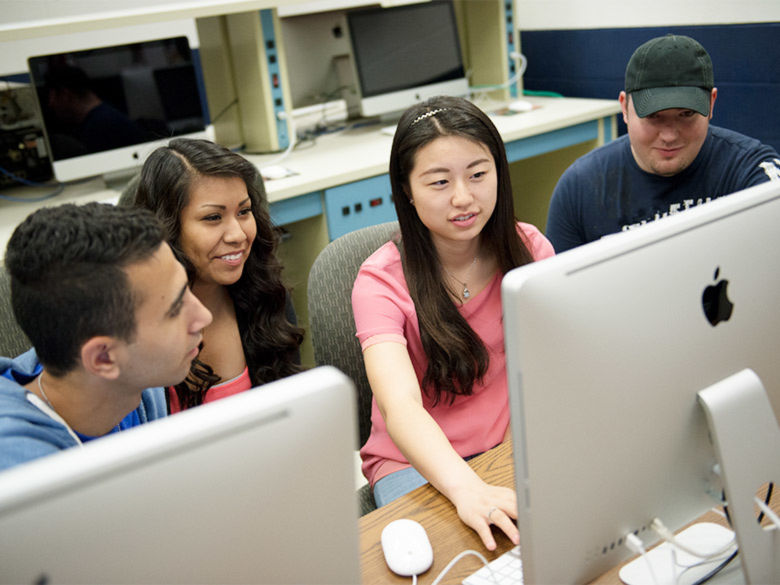 Four students in a computer lab