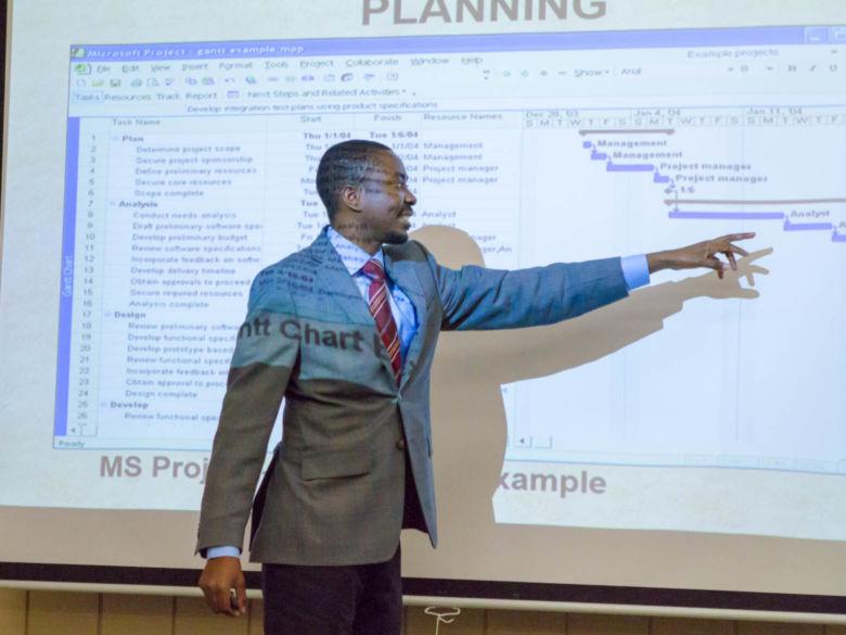 A professor discusses project management techniques