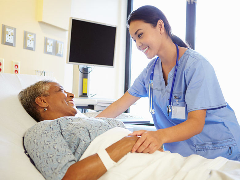 A nurse takes care of a patient in the hospital