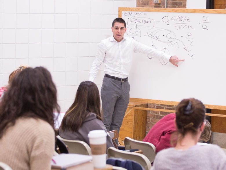 Andrea Patrucco teaches to a classroom full of students