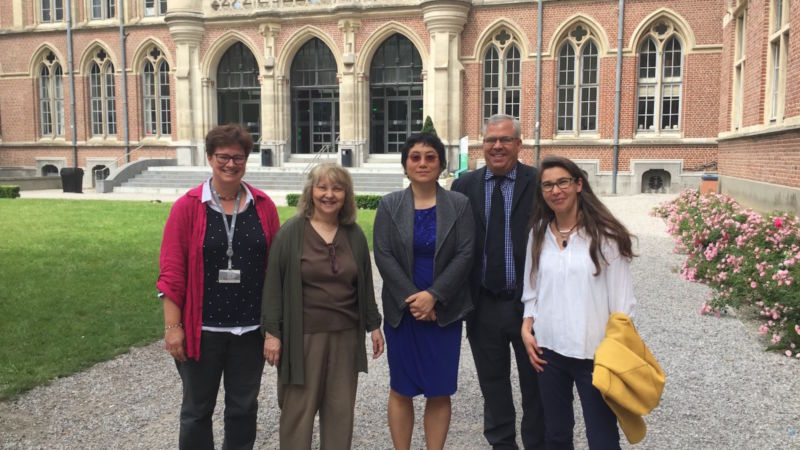 Five professors from Catholic University and Penn State stand in front of a building in France.