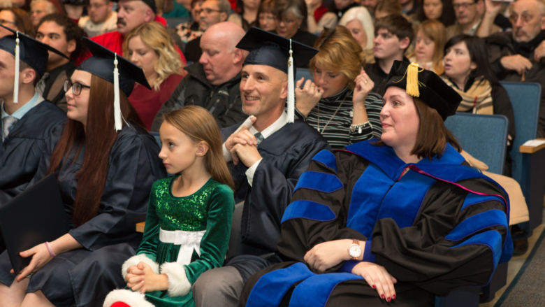 Penn State Beaver graduates, professors and guests look toward stage at commencement.