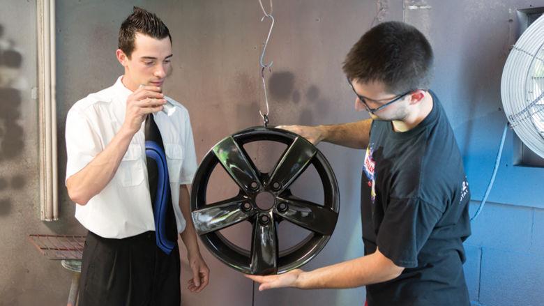 Josh Hogenmiller and his business partner work in their garage
