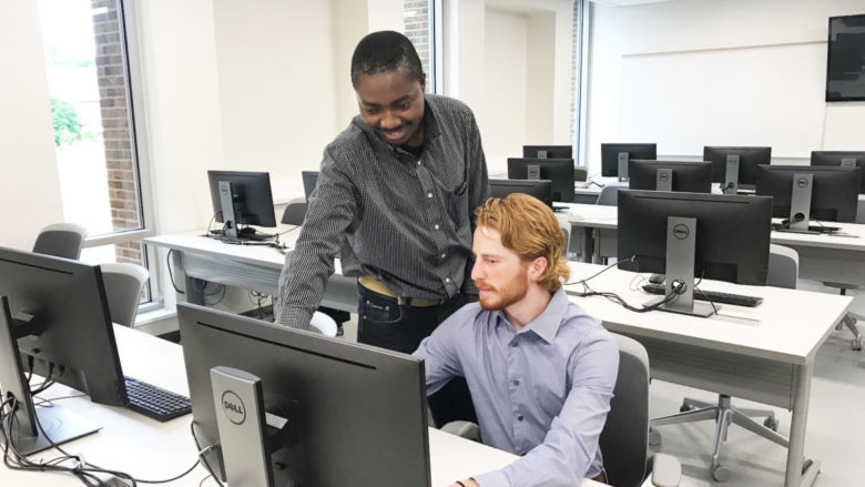 Richard Lomotey and Evan McStay in a computer lab
