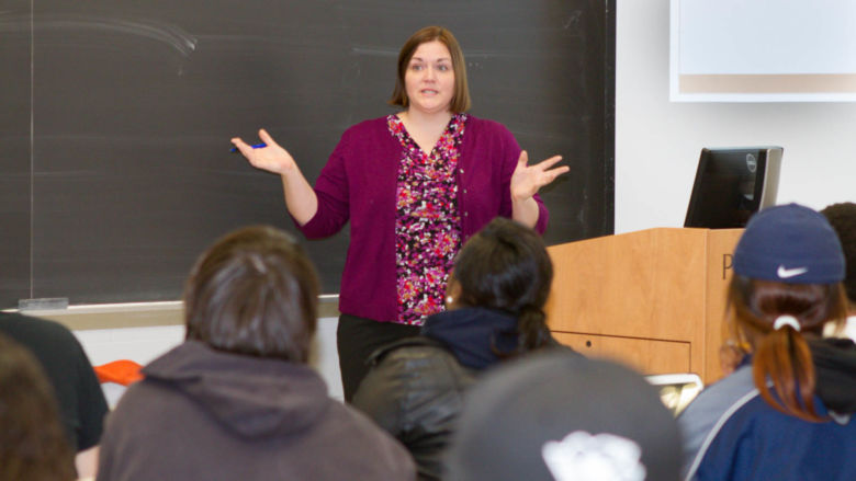 Associate Professor Mari Pierce lectures to a class.