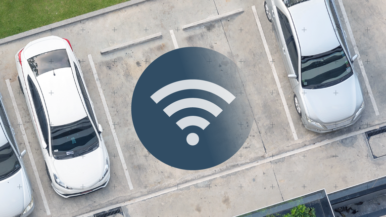 Image of parked vehicles with Wi-Fi symbol