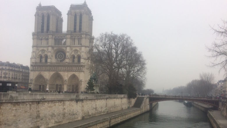 A shot of Notre Dame surrounded by fog.