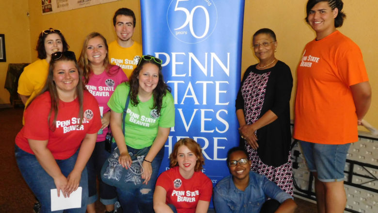 Penn State Beaver students take a break from volunteering to pose with the Franklin Center's Valerie McElvy.